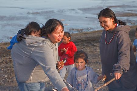 Yup'ik Eskimo women and children in Togiak, Alaska