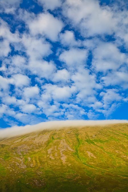 Clouds above peak on Round Island, Alaska
