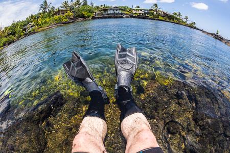 Snorkeler's Legs at Kapoho Tide Pools on Hawaii Big Island