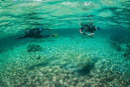 Snorkelers Reflections at Kapoho off Big Island of Hawaii