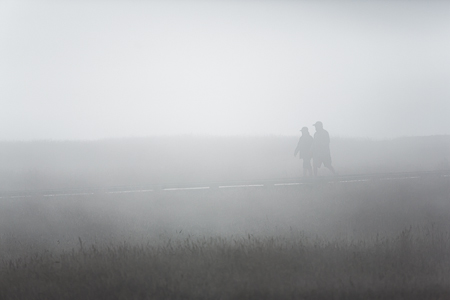 Couple in Fog along Trail in MacKerricher State Park