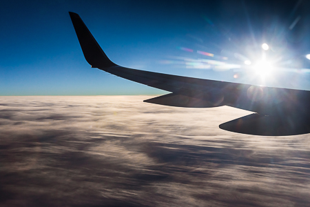 Wing of a Boeing 757 High Above Thick Clouds over the Great Plai