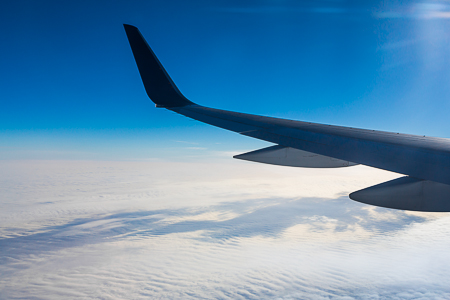 Wint of Boeing 757 over a Thick Blanket of Clouds