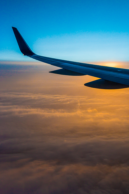 Wing of a Boeing 757 and Sunset Clouds over the Great Plains