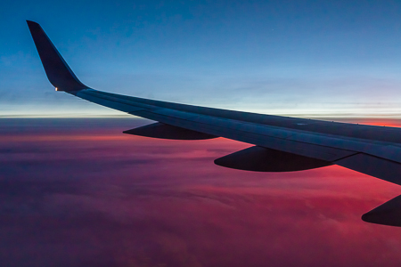 Wing of a Boeing 757 and Sunset Clouds over the Rocky Mountains