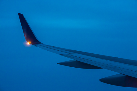 Wing of a Boeing 757 Descending into Twilight during Approach to