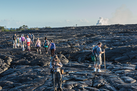 Group Hiking to View Hot Lava Entering Sea on Big Island