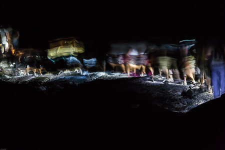 Hiking Group Returning at Night after Viewing Lava Entering Ocea