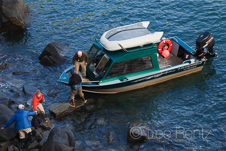 Charter boat loading passengers for trip back to Togiak