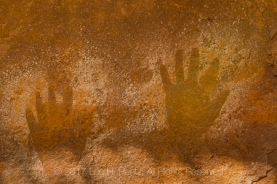 Handprints made over 800 years ago by Ancestral Puebloan people on the sandstone wallls of Salt Creek Canyon in The Needles District of Canyonlands National Park, Utah, USA