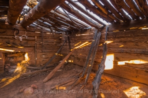 Kirk's Cabin, built as a seasonal shelter by a rancher, with adzed logs and a fireplace, in Salt Creek Canyon in The Needles District of Canyonlands National Park, Utah, USA