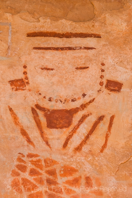Stylized pictograph, one of a group known as The Four Faces, created by an Ancestral Puebloan or Fremont artist, within Salt Creek Canyon in The Needles District of Canyonlands National Park, Utah, USA