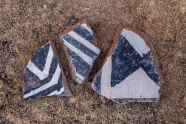 Potsherds in black-on-white style left by the Ancestral Puebloan people living at Big Ruin within Salt Creek Canyon in The Needles District of Canyonlands National Park, Utah, USA