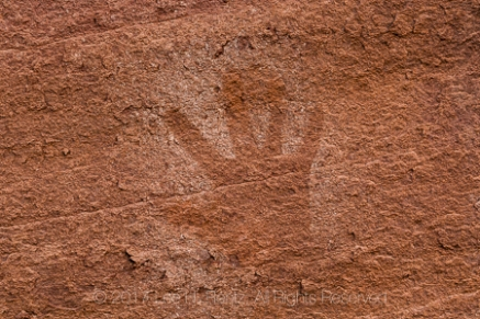 Hand Print at Big Ruin, an Ancestral Pueblo village site within Salt Creek Canyon in The Needles District of Canyonlands National Park, Utah, USA