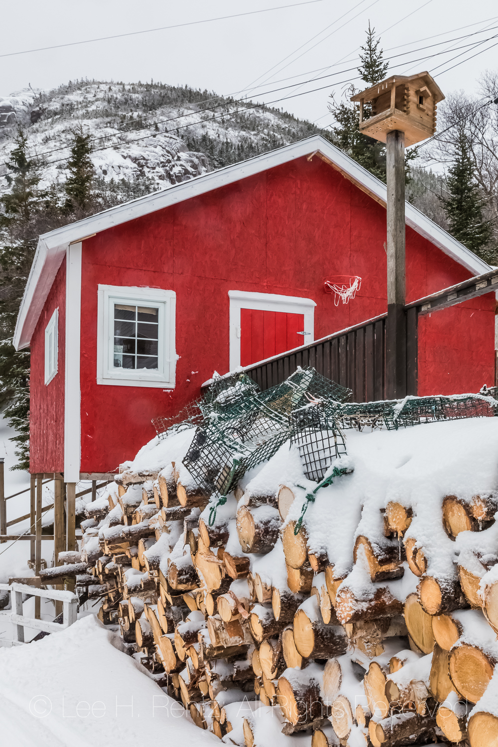 Fishing Boat in Francois Outport during a Snowstorm in Newfoundl