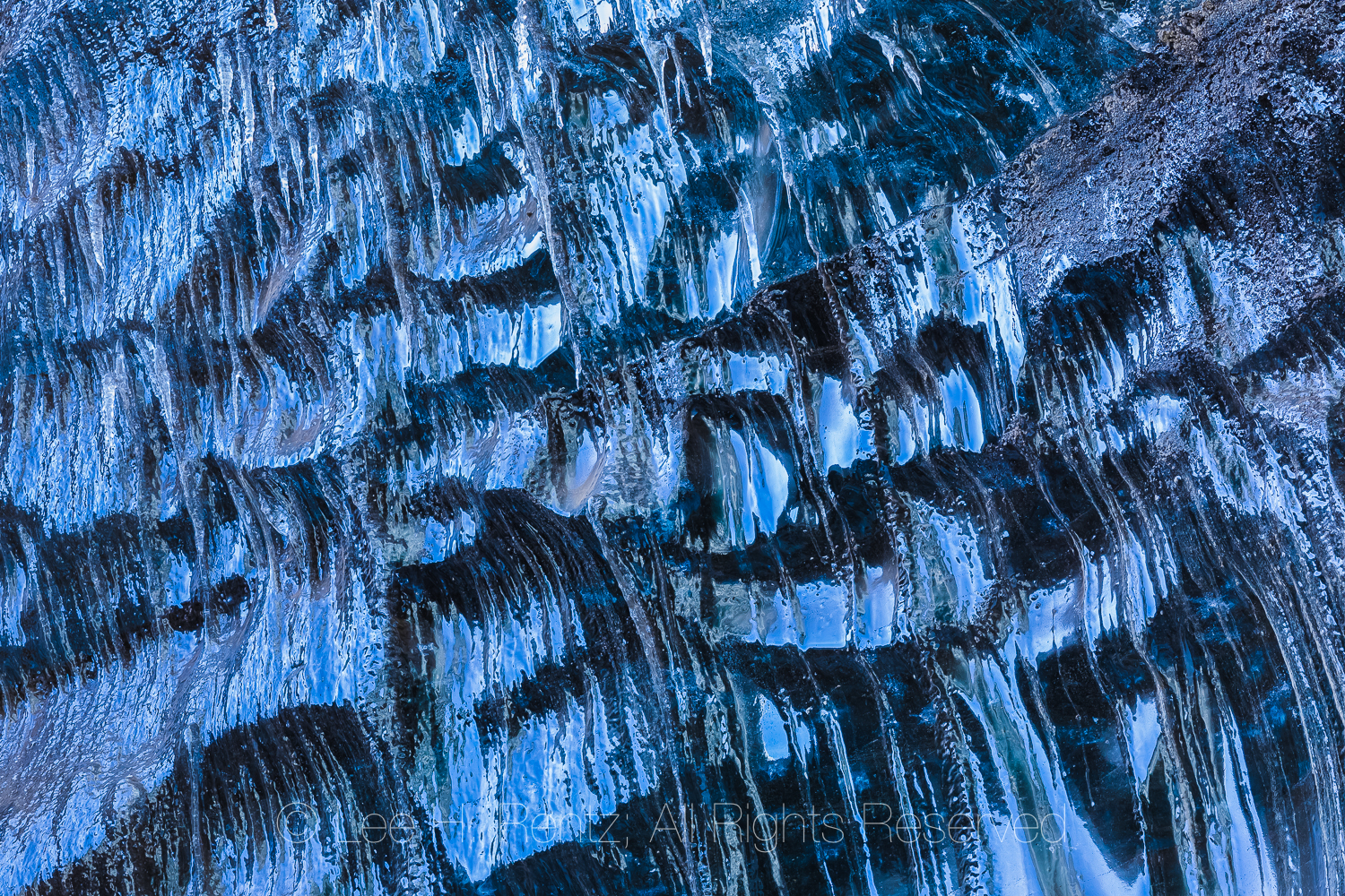 Icicles at entrance to an ice cave in a lobe of Mýrdalsjökull Glacier, which sits atop Katla Volcano, in winter in Iceland